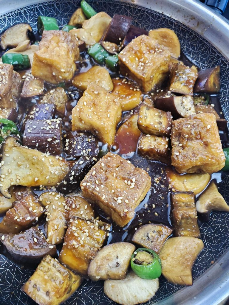 A close up overhead photo of the teriyaki eggplant & mushroom
