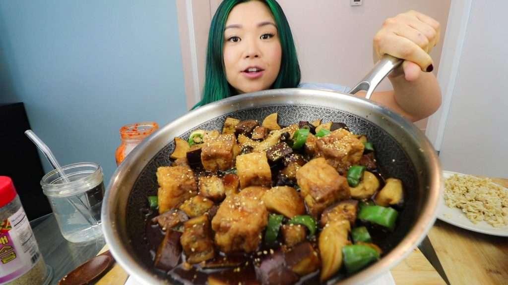 Rose Lee showing the cooked teriyaki eggplant & mushroom on a pan