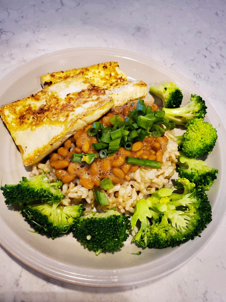 another easy vegan meal -- pan fried tofu and broccoli with rice, topped with natto and green onions