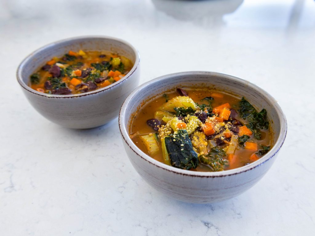 a photo of two bowls of the second ealthy comfort food recipe -- kaye & bean soup